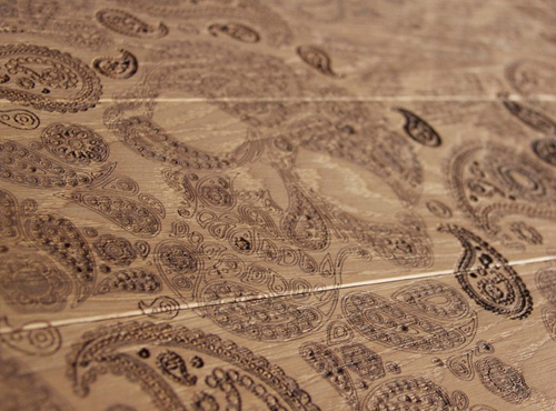 Paisley pattern carved into wood flooring