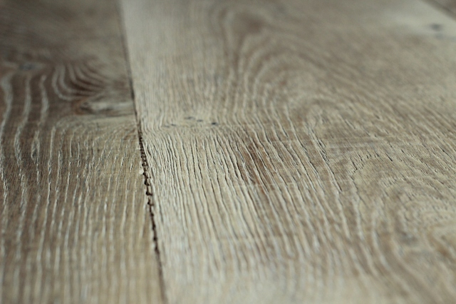 Grainy wood species like white oak are given texture by passing under ...